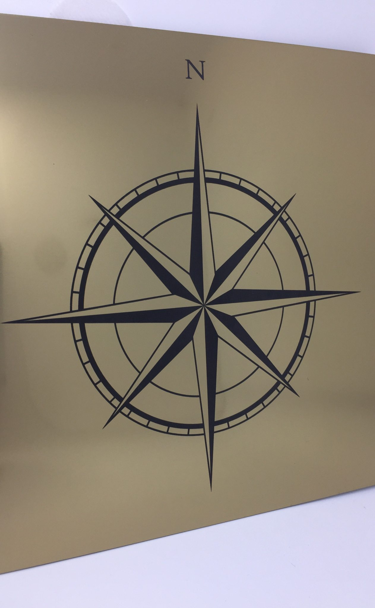 The Altered State -laser engraved laser etched compass design on engraving laminate