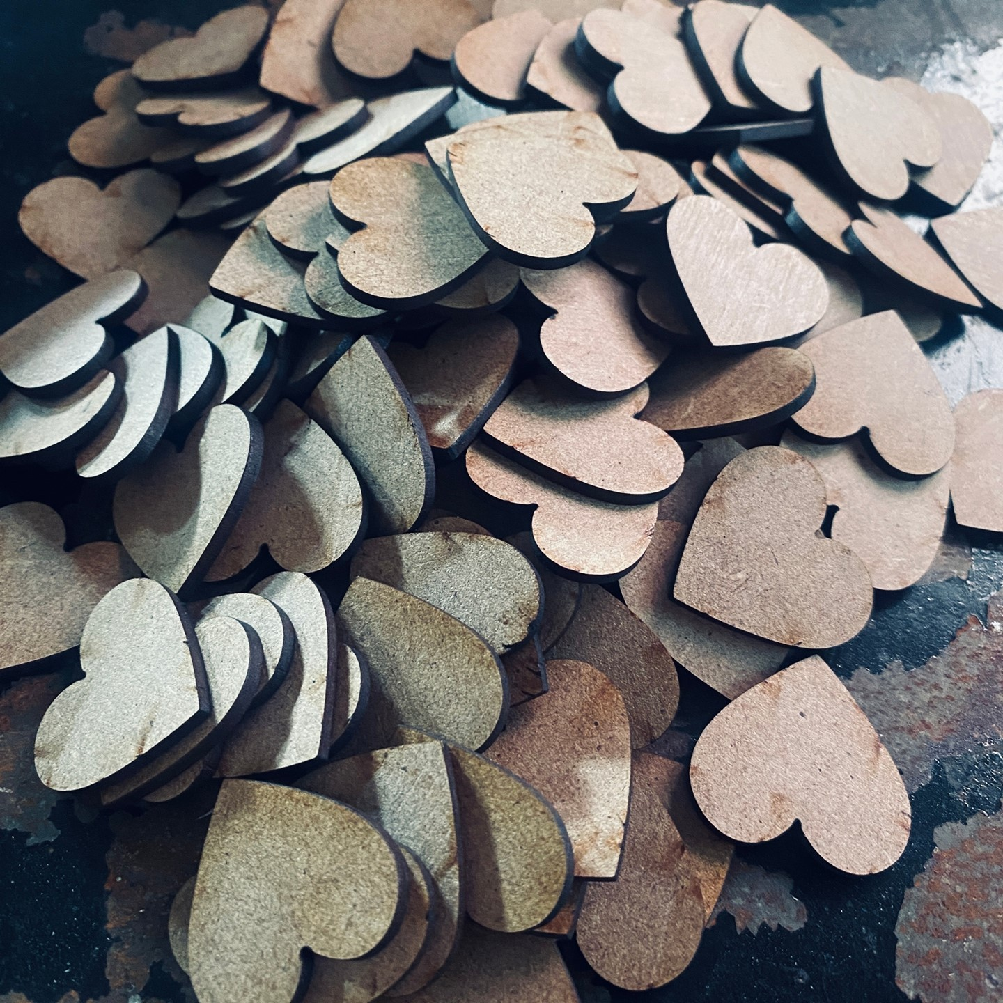 a pile of laser cut mdf hearts