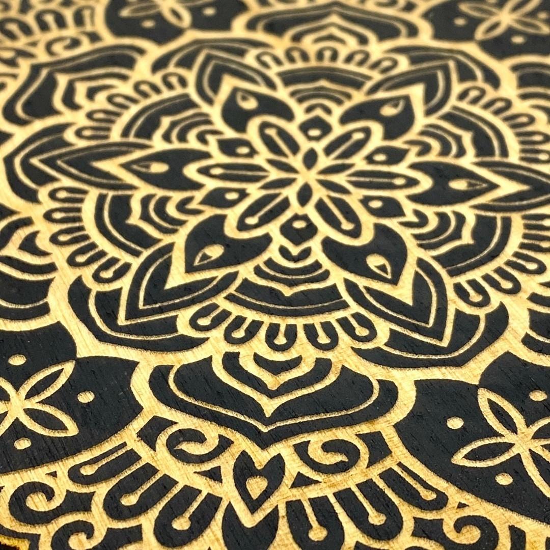 Laser-engraved-mandala-on-black-plywood