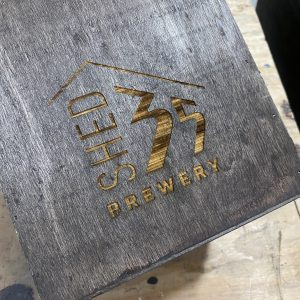 Beer carrier laser engraved with the Shed 35 Brewery logo