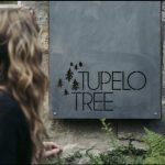 weathering steel and wood sign for tupelo tree made by the altered state
